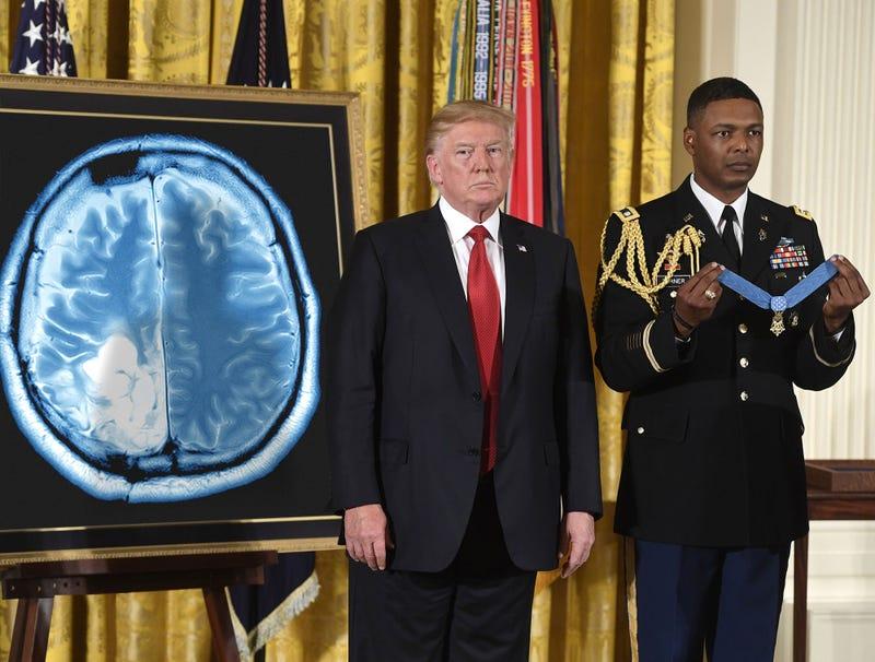 Illustration for article titled Trump Bestows Medal Of Honor On John McCain's Tumor