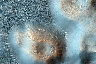 Illustration for article titled Martian mud volcanoes may hold the secret to life on Mars