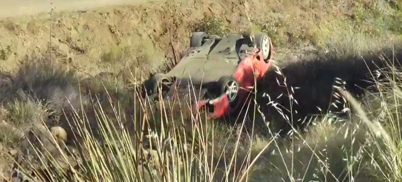 Illustration for article titled Every Driver's Nightmare: Ferrari Crashes Off Road In LA Canyons