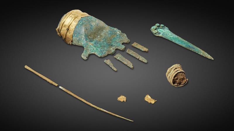 The bronze hand and other items found at the site in Switzerland.