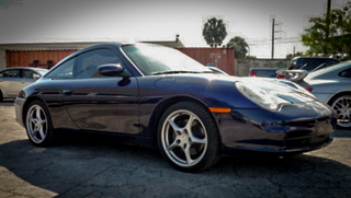 Illustration for article titled What Would You Do With This Crazy Cheap Porsche 911 Targa Project?