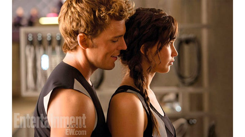 Illustration for article titled Finnick and Katniss Are Looking Preeeeetty Close in This Catching Fire Promo Pic