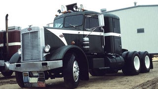 Here's a random idea that just hit me: a hot rod semi truck. The thing is, I want it to be capable of hauling trailers without issues. No slammed-to-the-ground stance, no chopping and channeling, none of that stuff that may be harmful for comfort and hauling. Like an old Mack, Peterbilt, Ford, or such in flat black, red classic five-spoke semi wheels, white walls, red and white pin-striping. And then for a trailer maybe something like a car carrier in the same paint scheme so you can haul cars but in with walls and glass windows so people can see what cool rides you're carrying. Crazy or not?