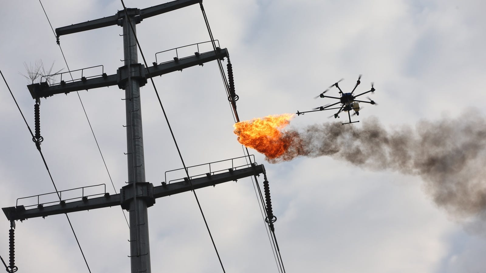 Power Company Sends Fire-Spewing Drone to Burn Trash Off High ...