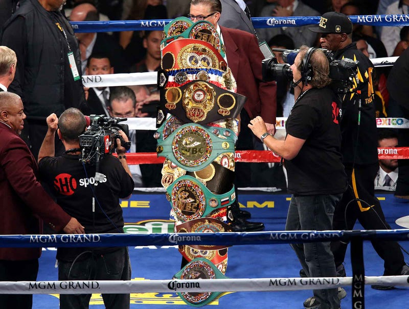 Illustration for article titled Floyd Mayweather Enters Ring Inside Cocoon Of Championship Belts