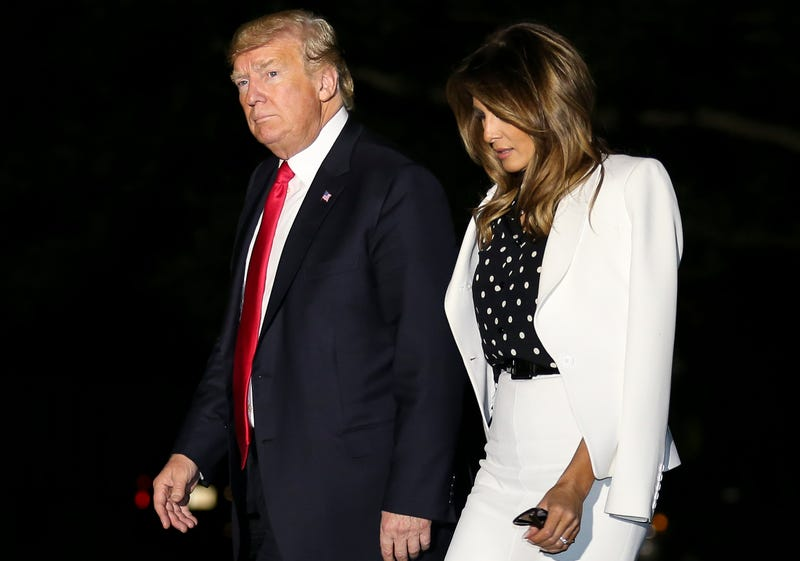 Donald Trump and Melania Trump walk across the South Lawn from Marine One to the White House on Aug. 24, 2018, in Washington, D.C.