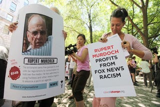Protests outside Murdoch's Fifth Ave. apartment in New York (Mario Tama/Getty Images)