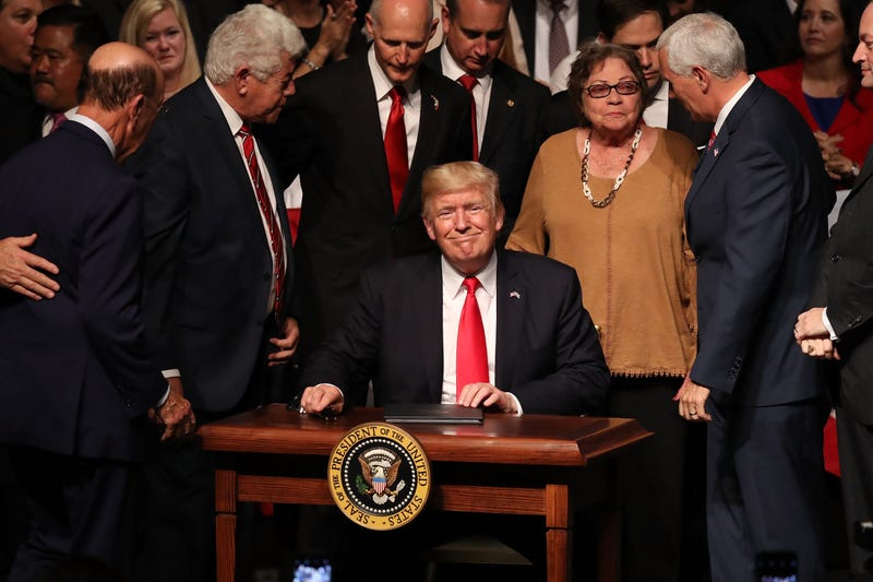 President Donald Trump smiles after signing policy changes he is making toward Cuba at the Manuel Artime Theater in the Little Havana neighborhood on June 16, 2017 in Miami, Florida.