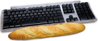 Illustration for article titled Baguette Computer Wrist Rest: Staff of Life Protects Your Carpal Tunnels
