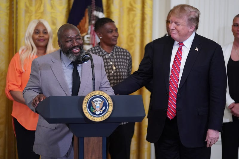 Matthew Charles, who was released from from federal prison after serving 20 years for selling crack cocaine, joins U.S. President Donald Trump for a First Step Act celebration in the East Room of the White House .