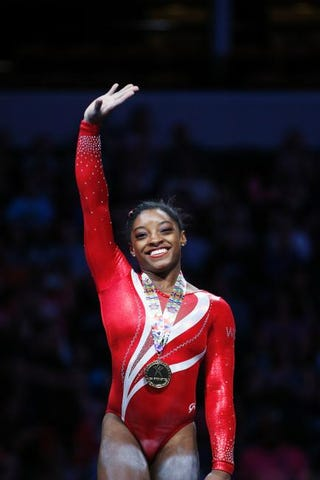 Simone Biles waves to the crowd after placing first in combined score in the women's finals of the 2015 P&G Gymnastics Championships Aug. 15, 2015, in Indianapolis.Joe Robbins/Getty Images