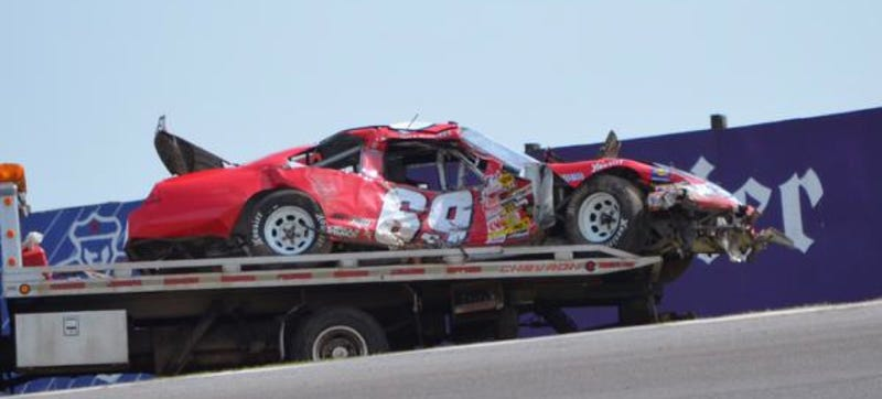 Illustration for article titled ARCA Stock Car Driver Flies Off Speedway Banking, Hits Fan's Truck