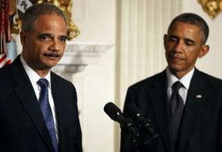 Attorney General Eric Holder with President Barack Obama while announcing his resignation Sept. 25, 2014, in Washington, D.C. The president said Holder will remain in office until a successor is nominated and confirmed. Mark Wilson/Getty Images