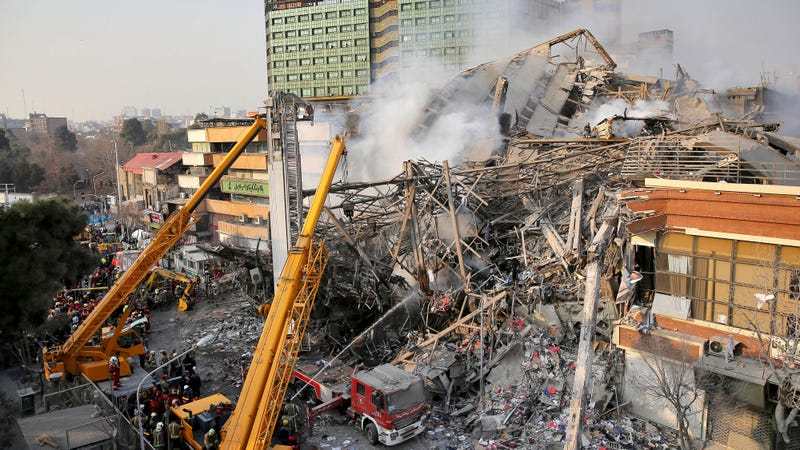 Firefighters at the scene after the collapse of the Plasco building in Tehran. Photo: AP