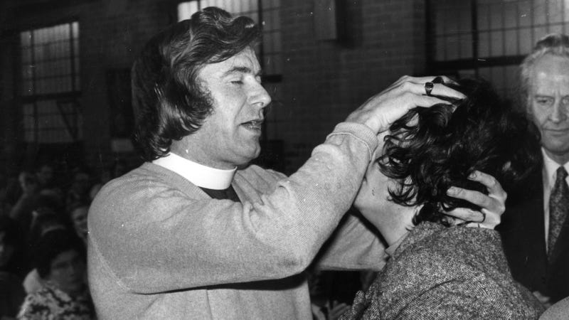 A Catholic priest performs an exorcism in England in 1975. (Photo: David Ashdown/Getty Images)