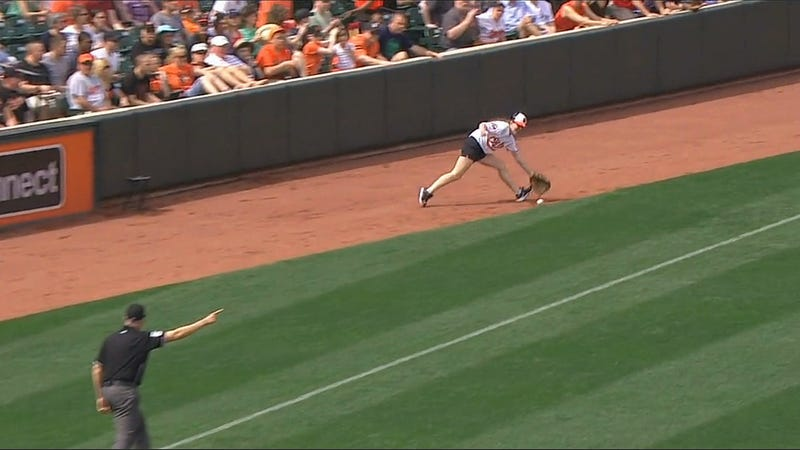 Illustration for article titled Orioles Ball Girl Ignores Umpire, Fields Live Baseball
