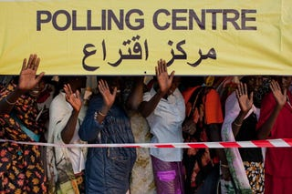 Southern Sudan voters wait in line to vote.