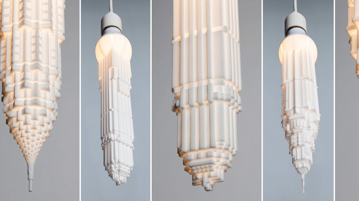 inverted skyscrapers hang like glowing stalactites from your led bulbs