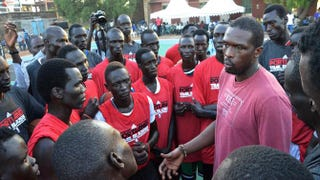 NBA player Luol Deng talks to young people during a practice session in Juba, South Sudan, Aug. 5, 2015.SAMIR BOL/Getty Images