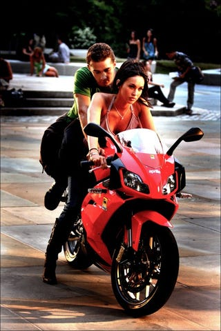 Illustration for article titled Megan Fox Takes Shia LaBeouf For An Aprilia Ride In Transformers 2