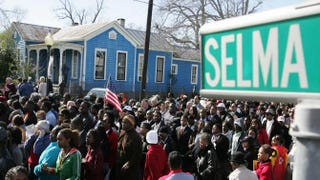 A large crowd marches down the streets of Selma, Ala., in 2007 while re-creating a peaceful voting-rights march that was violently repressed by Alabama troopers in 1965. ROBERTO SCHMIDT/AFP/Getty Images