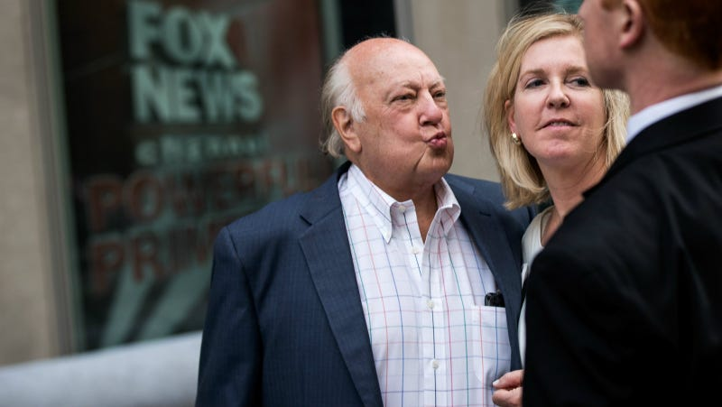 Ailes walks with his wife Elizabeth Tilson as they leave the News Corp building in July. Photo via Getty.