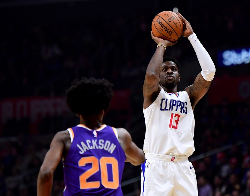 Jamil Wilson, No. 13, of the Los Angeles Clippers scores on a jumper over Josh Jackson, No. 20, of the Phoenix Suns during the first half of a game at Staples Center on Dec. 20, 2017, in Los Angeles. (Harry How/Getty Images)