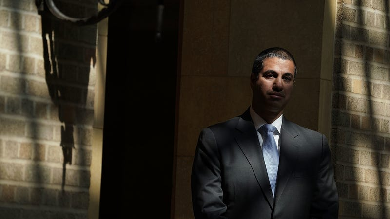 FCC Chairman Ajit Pai waits to be introduced during a forum April 18, 2018 in Washington, DC.