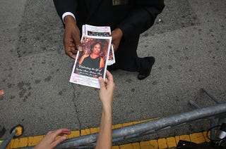 A program with a cover photograph of Cynthia Hurd, 54, is handed out before her funeral on June 27, 2015, at the Emanuel African Methodist Episcopal Church in Charleston, S.C.  (Joe Raedle/Getty Images)