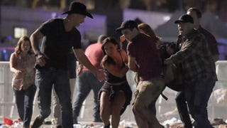 An injured concertgoer is carried at the Route 91 Harvest Country Music Festival in Las Vegas after a gunman opened fire, killing at least 50 people, Oct. 1, 2017. (David Becker/Getty Images)