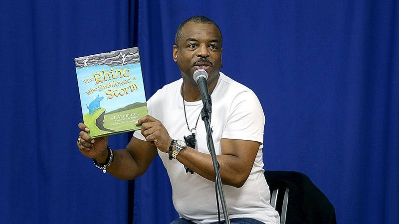 LeVar Burton reads from copies of his book The Rhino That Swollowed A Storm in 2014 in Austin, Texas. (Photo: Gary Miller/Getty Images)