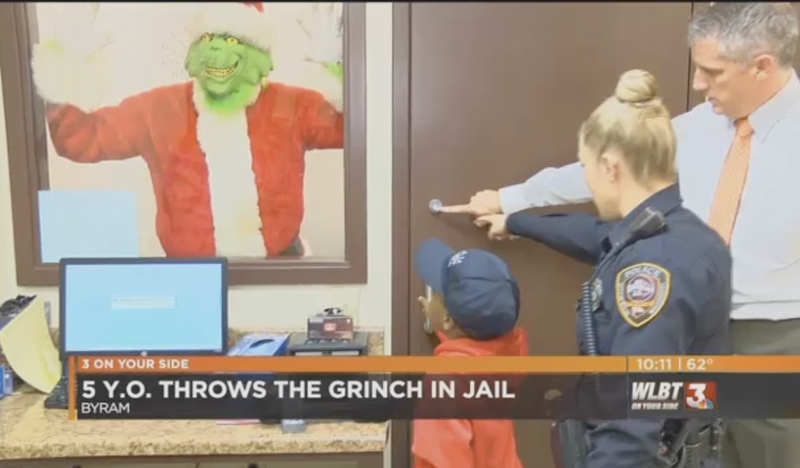 TyLon Pittman locks the Grinch away in a holding cell. (Mississippi News Now screenshot)