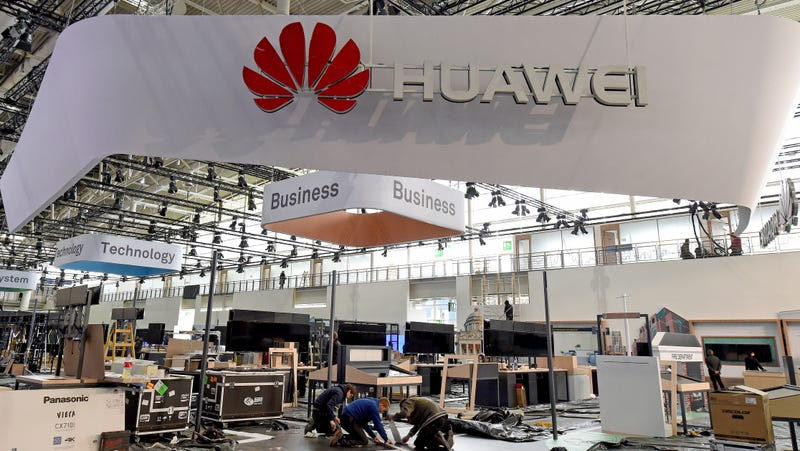 A Huawei booth under construction in Hannover, Germany for the CeBIT tech fair in 2017.