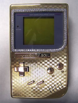 Illustration for article titled Gold and Diamond Covered Original Game Boy