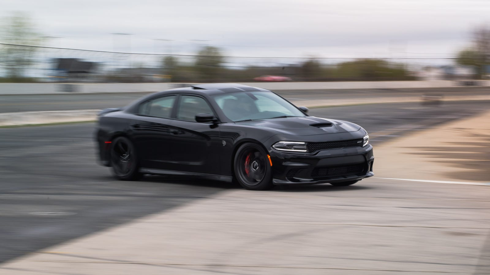 How I Survived A Dodge Charger Hellcat On A Wet Track
