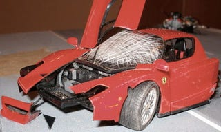 Illustration for article titled Gizmondo Ferrari Enzo Crash Perfectly Recreated In Scale Form