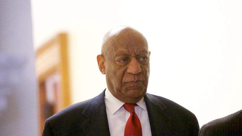 Cosby walks after the guilty verdict was announced Thursday.