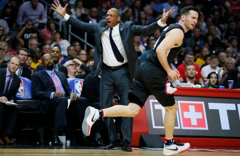 Doc imploring our heckler to do better (via AP). Note: That's not what is actually happening in this picture.