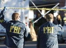 FBI descends on home of pipe-bomb suspect.