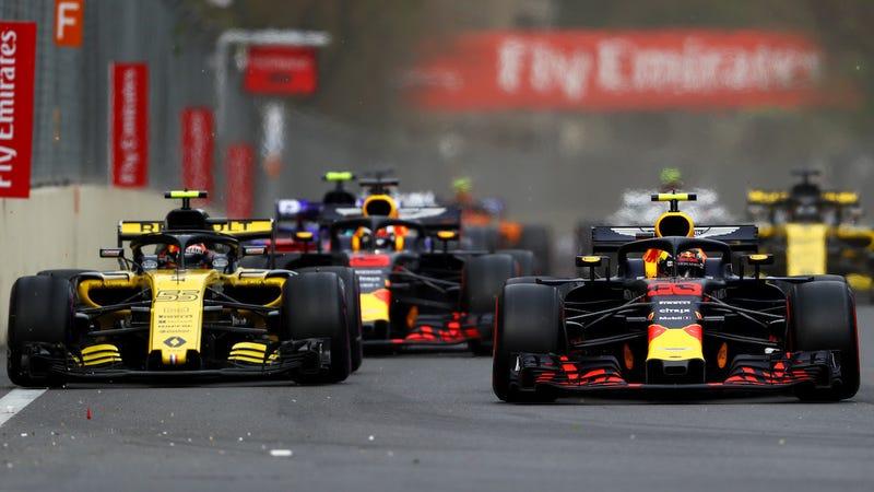 Carlos Sainz and Max Verstappen at the Azerbaijan Grand Prix.