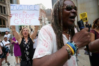 A small and peaceful group of demonstrators gather to protest in front of the Baltimore City Circuit Courthouse East, where pretrial hearings will be held for six police officers charged in the death of Freddie Gray Sept. 2, 2015, in Baltimore.Chip Somodevilla/Getty Images