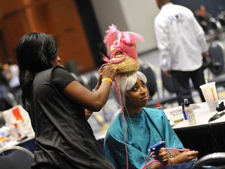 A model gets her hair done before the show (Kea Taylor/Imagine Photography).