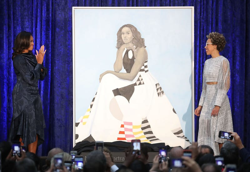 Former first lady Michelle Obama and artist Amy Sherald unveil her portrait during a ceremony at the Smithsonian's National Portrait Gallery on Feb. 12, 2018, in Washington, D.C.