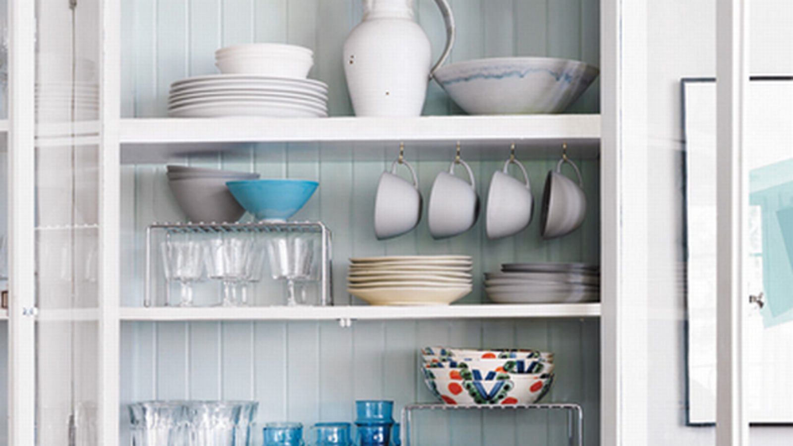 Hang Cups And Use Wire Racks To Maximize Kitchen Cupboard