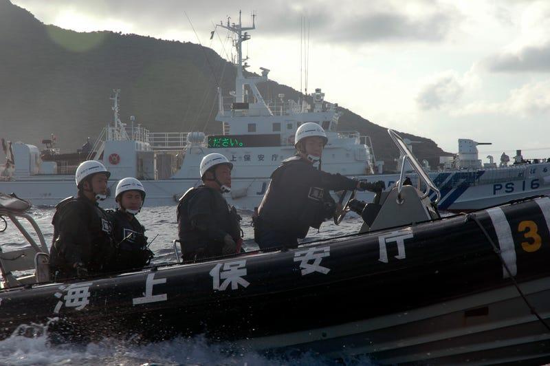 Japanese Coast Guard members, photo credit: AP