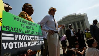 Supporters of the Voting Rights Act gather outside the U.S. Supreme Court building on June 25, 2013, in Washington, D.C.Win McNamee/Getty Images