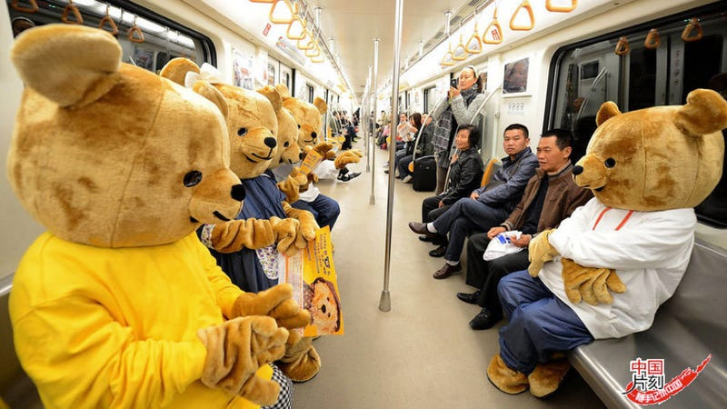 Illustration for article titled There are Giant Teddy Bears Riding the Subway. They Seem Friendly.