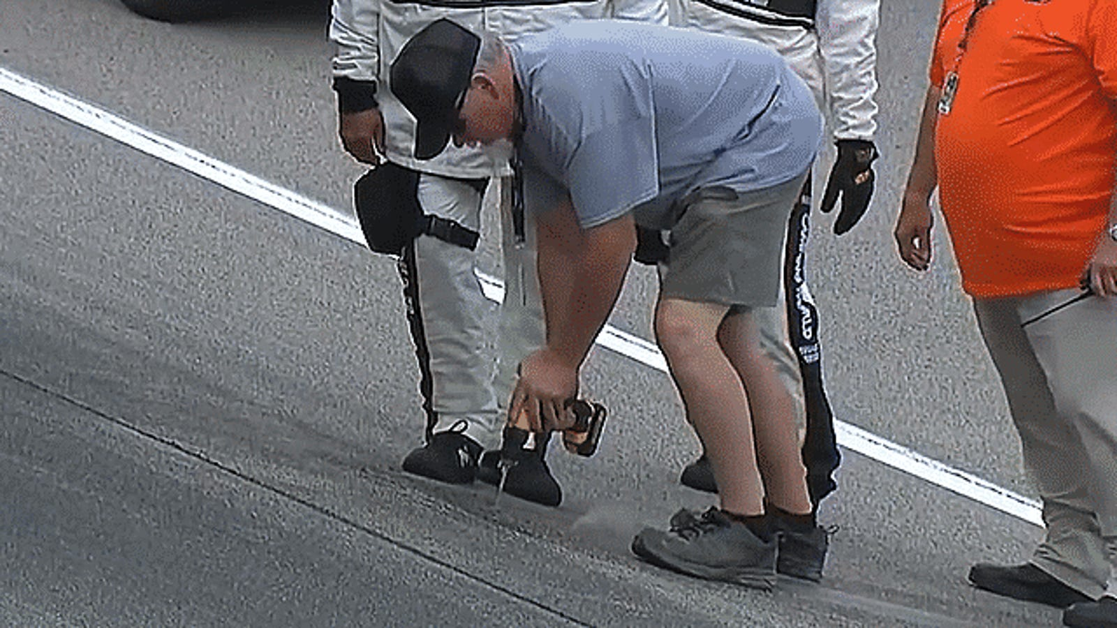 Watch NASCAR Officials Use Power Tools To Extract Water Trapped Under The Kansas Speedway