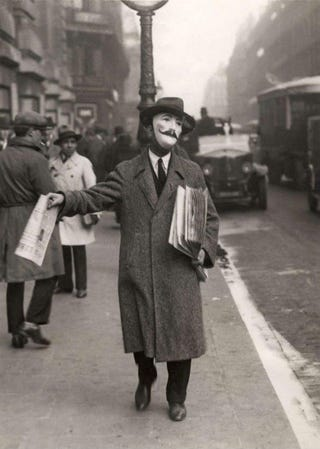 Illustration for article titled Long before V for Vendetta this newspaper seller wore a mustached mask