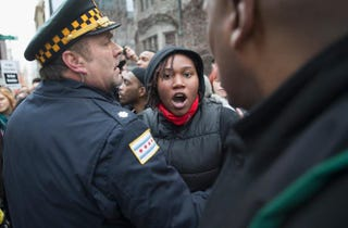 Demonstrators march along the Magnificent Mile shopping district on Michigan Avenue in Chicago to protest police abuse Dec. 13, 2014.Scott Olson